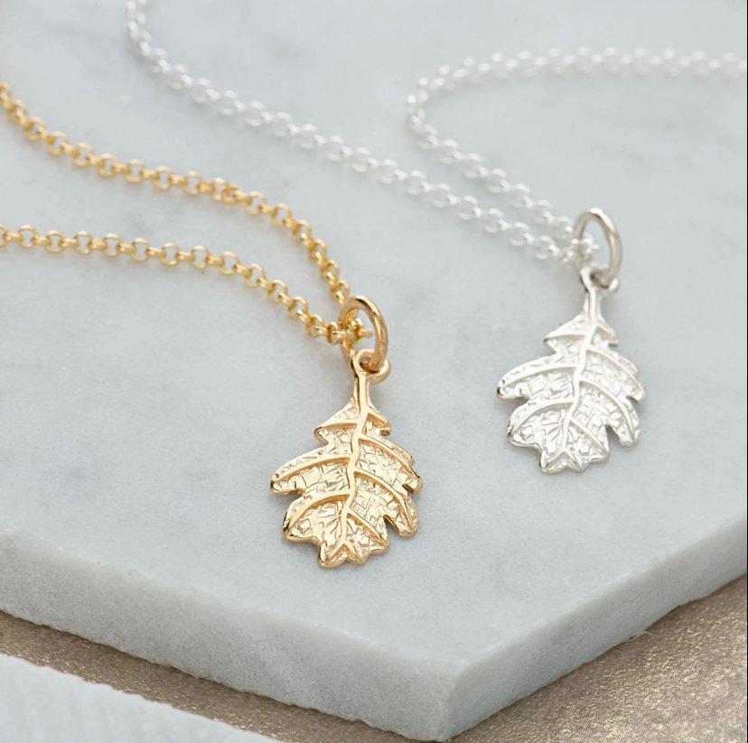 Gold or silver textured oak leaf charm on a necklace or bracelet