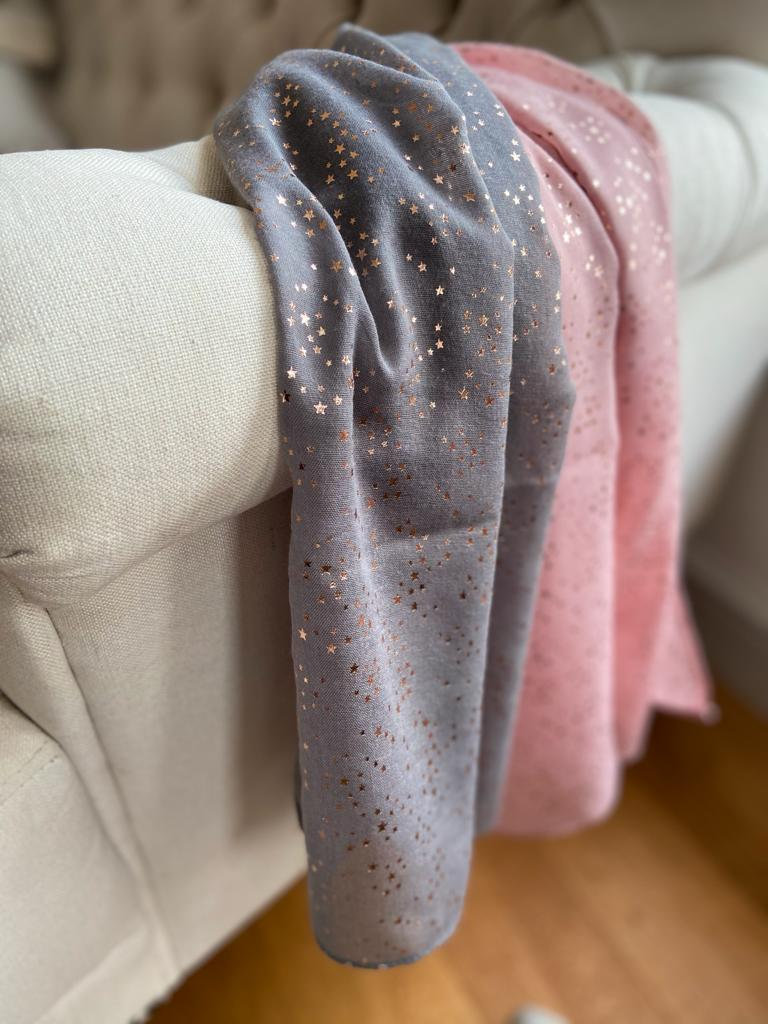 grey scarf with sparkly stars on it