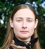 Profilbild av Karin Althen. Kvinna med blå ögon tittar in i kameran.