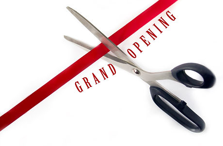 Scissors cutting red ribbon Isolated on white background.jpg