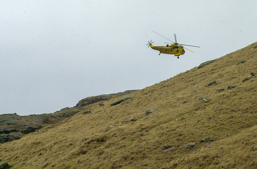 Mountain Rescue Helicopter over the hills