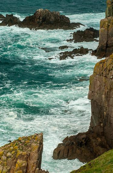 White sea froth around the cliffs