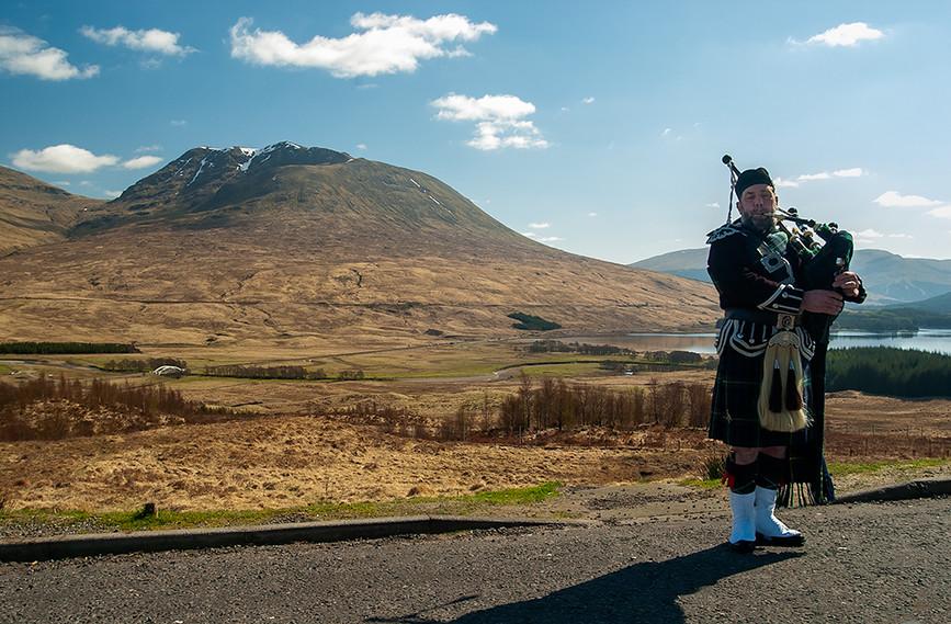 Scottish Piper in front of Loch Tulla & Beinn an Dothaidh