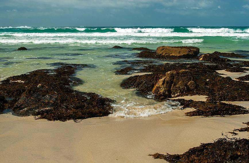 Surf rolling into Whitesand Bay