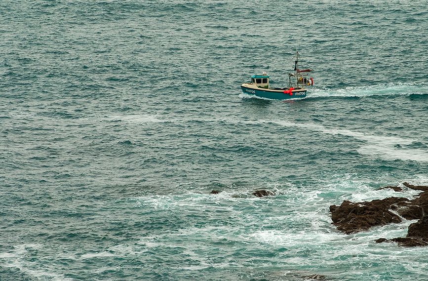 Fishing boat travelling past Lizard Point