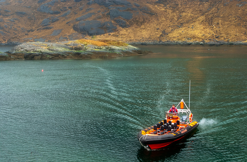 Rib boat approaching landing stage - Loch na Cuilce 02