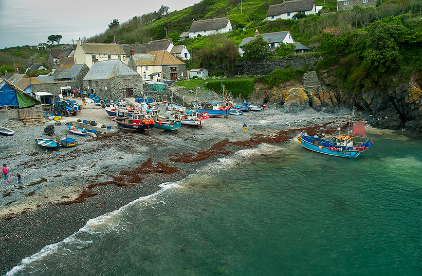 Cadgwith cove with beached fishing boat ready to be winched