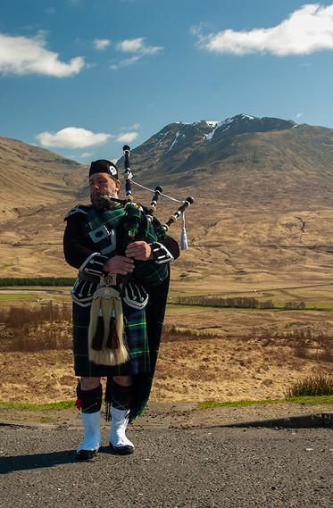Scottish Piper above Loch Tulla & Beinn an Dothaidh