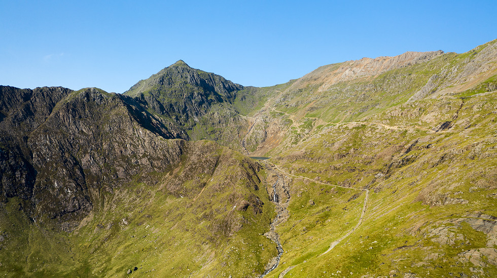 View towards Mount Snowdon with small waterfall dropping from Glaslyn to Llyn Llydaw