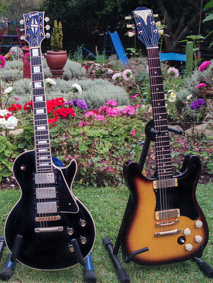 1960 Gibson Black Les Paul (left) and Gibson Double Cut Les Paul (right)