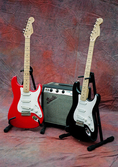 Red & Black Fender Stratocasters with Fender Champ Amplifier