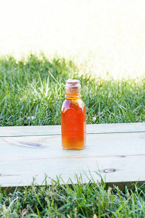 4oz glass Muth  Raw Honey