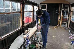 James Broughton planing wood to create b