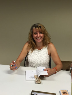 Larissa Reinhart at East Moline Library event