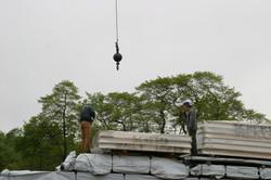 crane lifting construction material