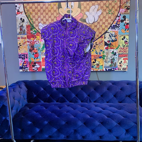 Purple_floral_windbreaker_with_sleeves_cut_off._Todrick_wore_this_in_the_90s_