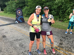 With Sarah and our finisher medals.jpg