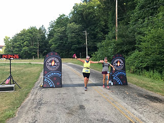 Crossing the finish with Sarah.jpg
