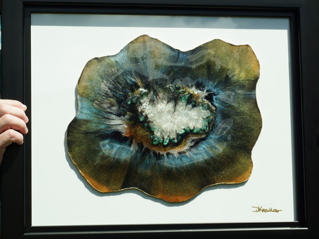 Resin Geode with color shift pigments,crystals and gold leafed edges.  Geode is mounted on a frame.