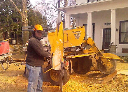 Owner scott Drake using a stump grinder