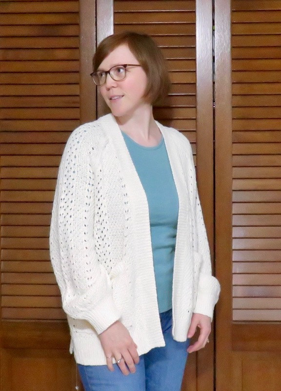 cream lacy cardigan with aqua shirt and jeans