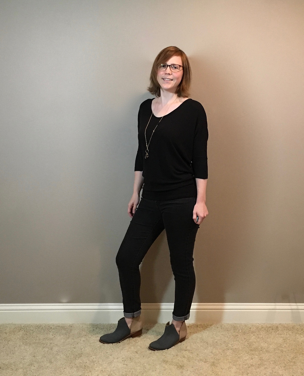 black sweater with black jeans and ankle boots