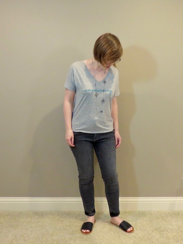 grey tee shirt, black jeans