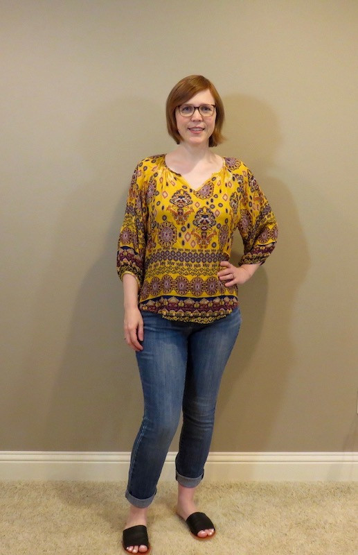 mustard colored top with denim pants