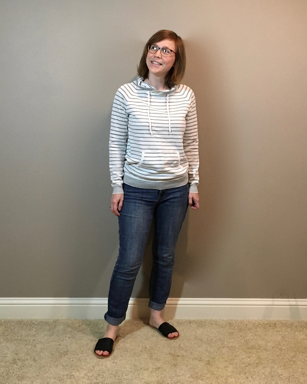 grey and white striped sweater with denim pants