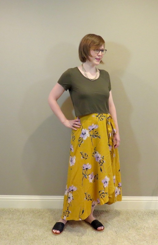 green tee shirt and floral mustard skirt