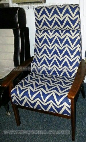 Reupholstered arm chair in blue angled fabric