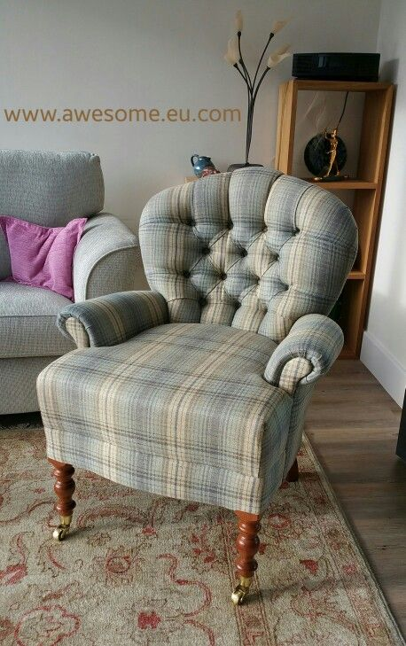 Reupholstered button backed wing chair