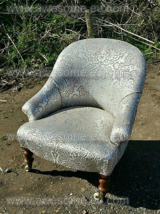 Reupholstered metalic tub chair