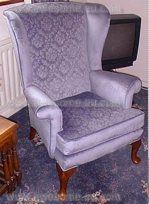 Reupholstered arm chair in embossed blue velvet