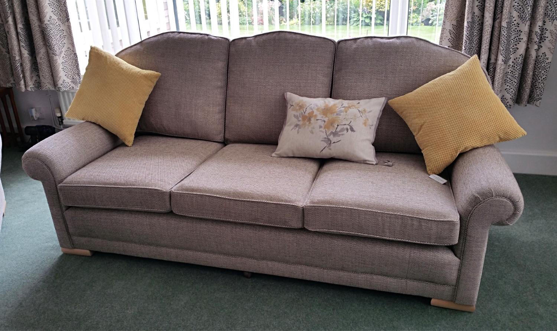 Reupholstered three seater sofa