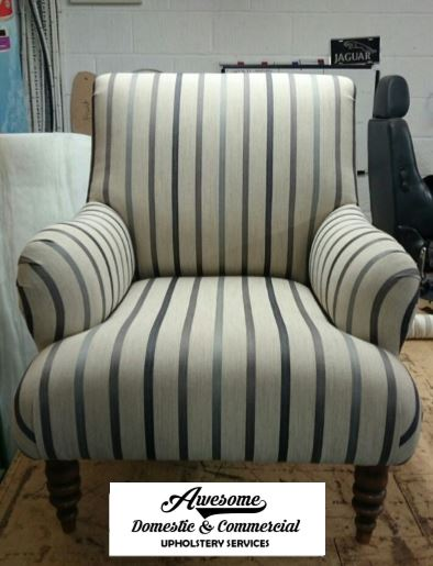 Reupholstered arm chair in striped fabric