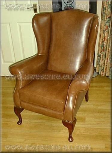 Reupholstered Faux leather wing arm chair