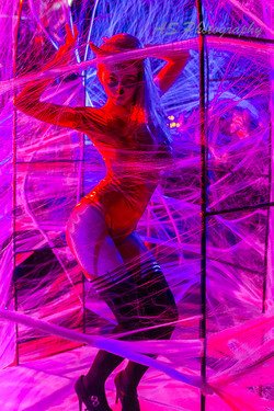Dancer in web cage