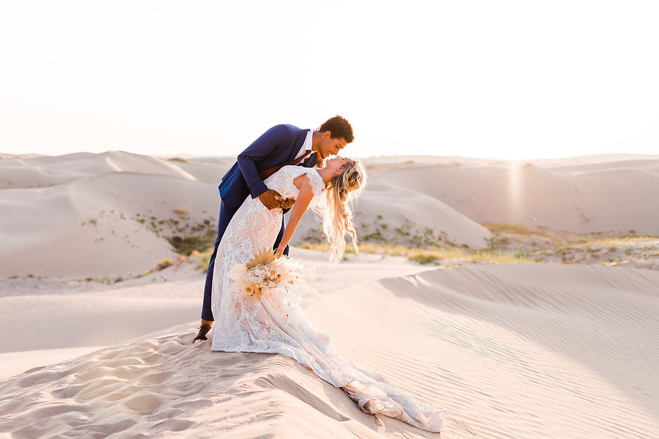 Interracial couple elopes at the Little Sahara sand dunes