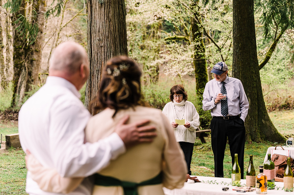 The mother and father of the bride tear up during their speeches at their daughter's elopement