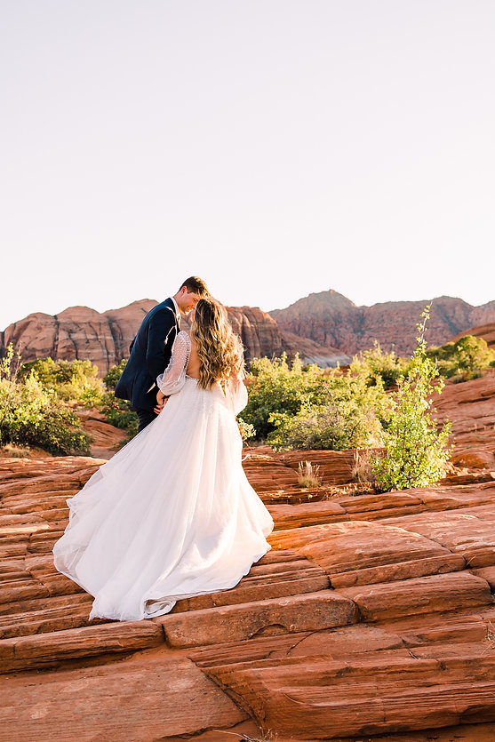 Utah Elopement Photographer captures bride and groom amongst red rocks in Snow Canyon