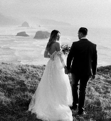 Couple looks at the view on the Oregon Coast at their elopement