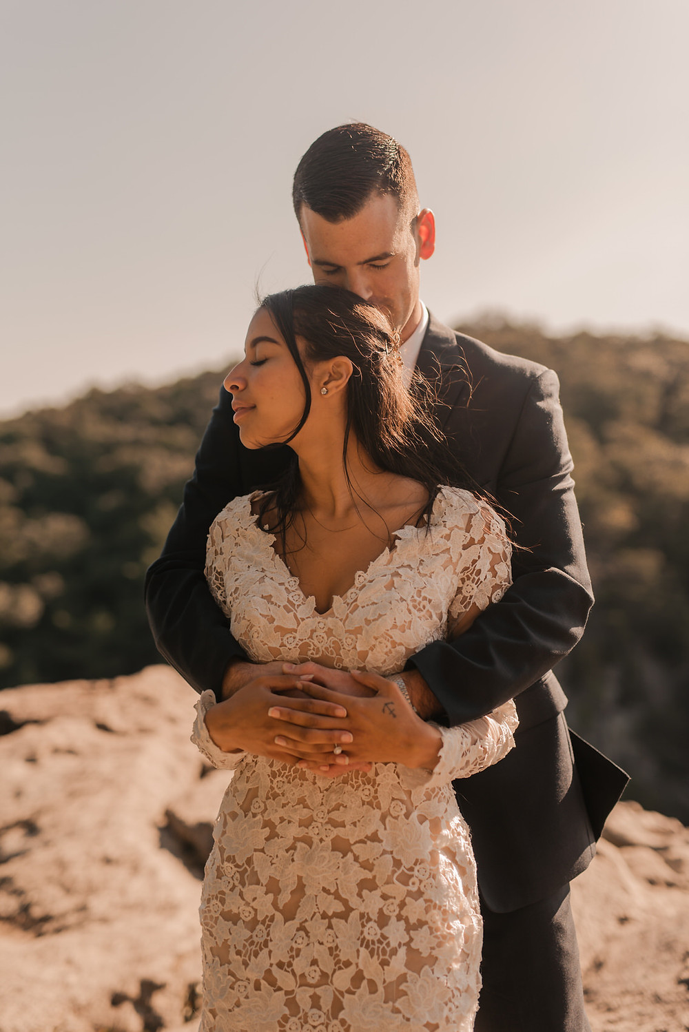 Interracial couple embraces at their elopement