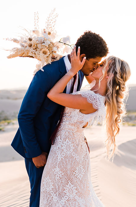 Interracial couple kisses at their elopement