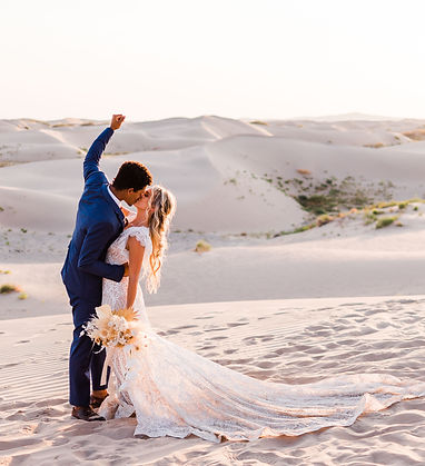 little sahara elopement in utah with a groom's fist in the air