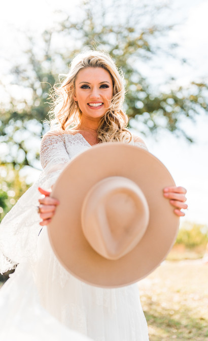 Rustic bride poses for a wedding portrait at this elopement in Tampa, Florida