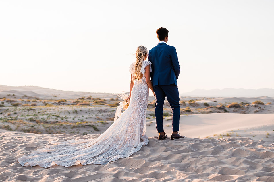 A lace dress on a beautiful blonde bride at her elopement
