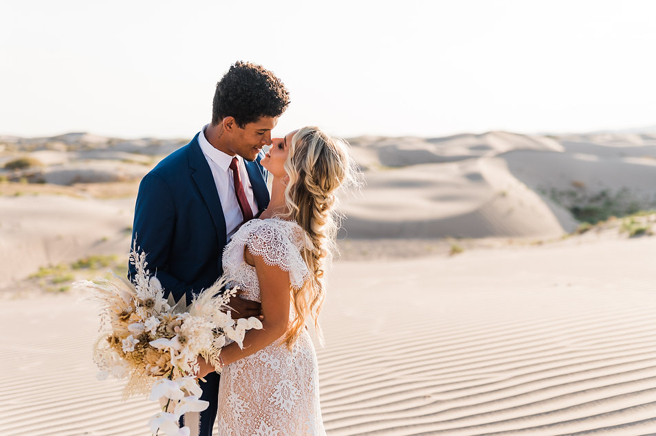 Intimate, romantic image of a man and woman eloping at the Little Sahara sand dunes