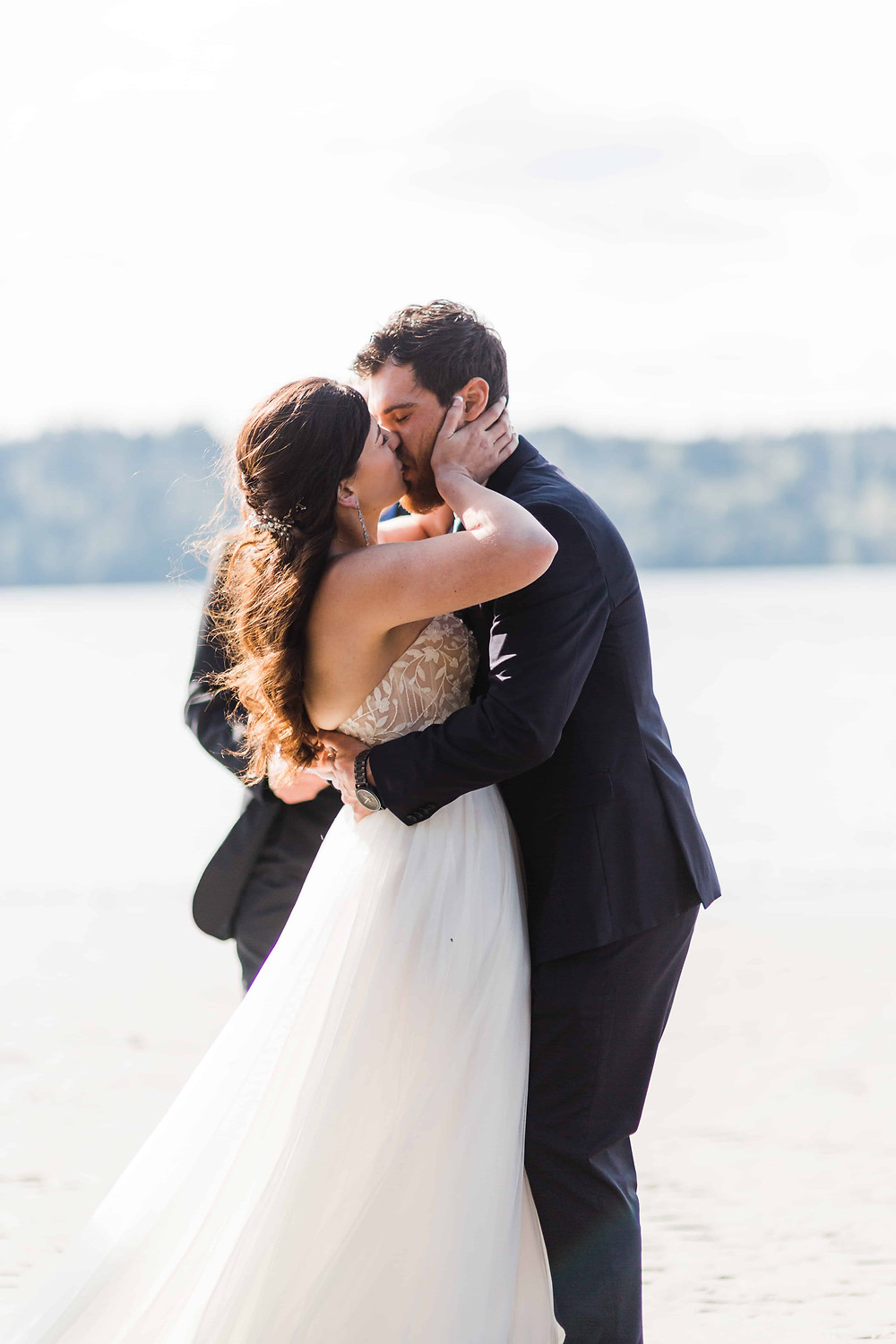 A man and a woman share their first married kiss at their elopement ceremony!