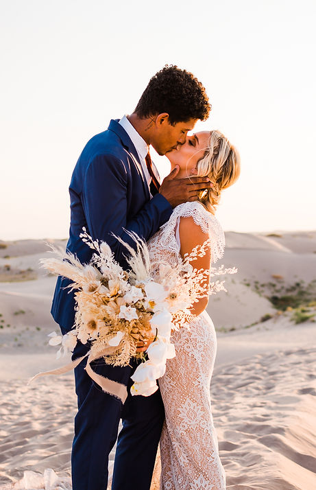 Interracial couple kisses at their adventure elopement